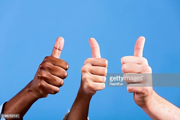 Three thumbs up of approval, with copy space