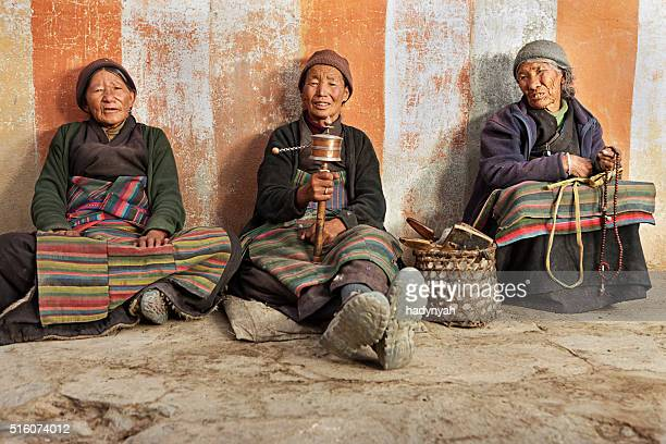Three Tibetan women praying in Lo Manthang, Nepal