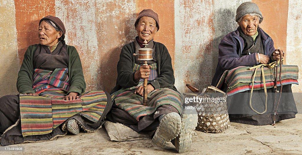 Three Tibetan women praying