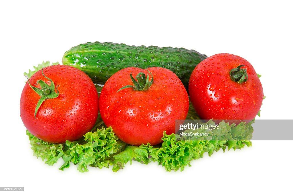 Three tomatoes and cucumber : Stock Photo