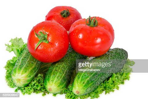Three tomatoes and three cucumber : Stock Photo