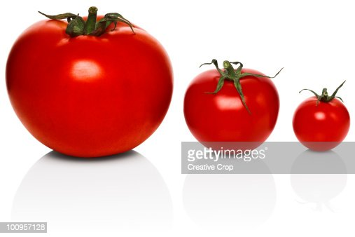 Three tomatoes of different sizes : Foto de stock
