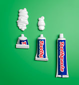 Three Toothpaste Tubes and Toothpaste