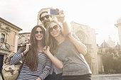 Three tourists taking self portrait, Plaza de la Virgen, Valencia, Spain