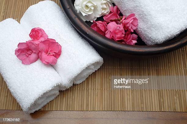 three towels on pamper mat