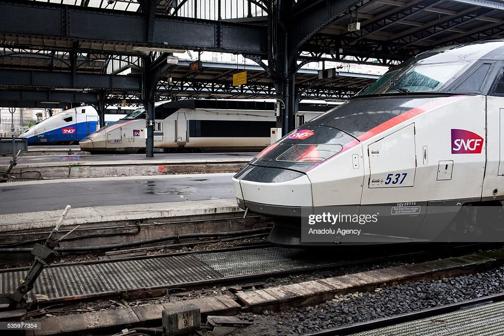 Three trains TGV from SNCF company wait at Paris Gare de l'Est Train Station, Paris, France on May 31, 2016.