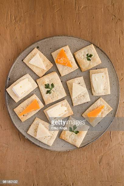 Three types of cut cheese on homemade cracker