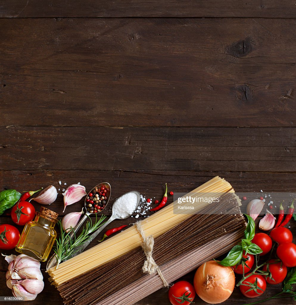 Three types of spaghetti, vegetables and herbs : Stock Photo