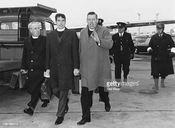 Three Ulster Protestant Clergymen including the Reverend Ian Paisley right with police at London Airport after shouting disapproval at Dr Ramsey...