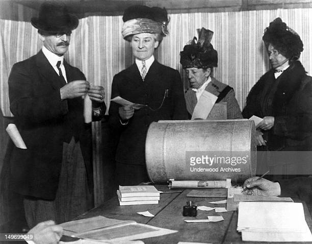 Three unidentified women make history by becoming the first of their sex to vote in an election after the 19th Amendment was passed San Francisco...