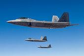 Three U.S. Air Force F-22 Raptors cruise above Nevada.