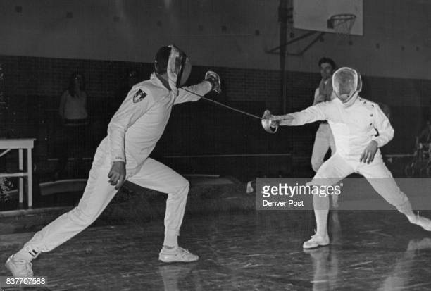 Three Weapon Team Title Wakefield left of Colorado fencing Club and Tim Barringer of CU squad A men's and women's open foil competition is next on...