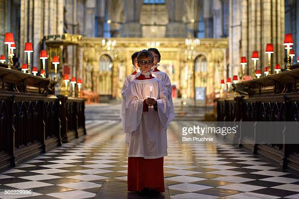 Three Westminister Abbey choristers pose for photographs in Westminster Abbey on December 21 2015 in London England The choristers made up of...