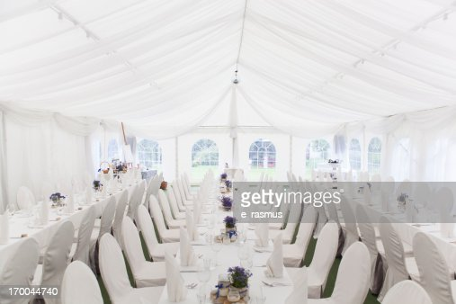 Three white banquet tables with white settings