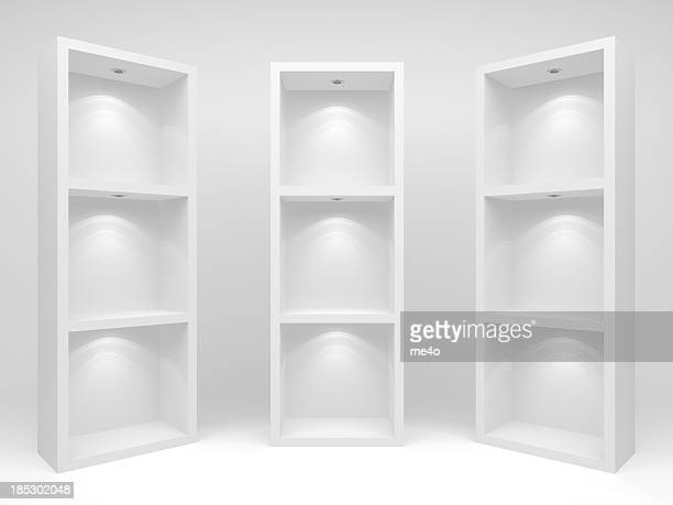Three white cd racks or bookcases on a white background