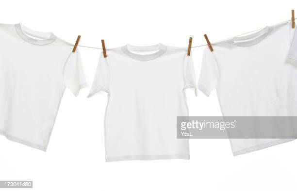 Three white T-shirt hanging on the  clothesline