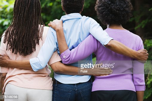 Three Women Arm in Arm