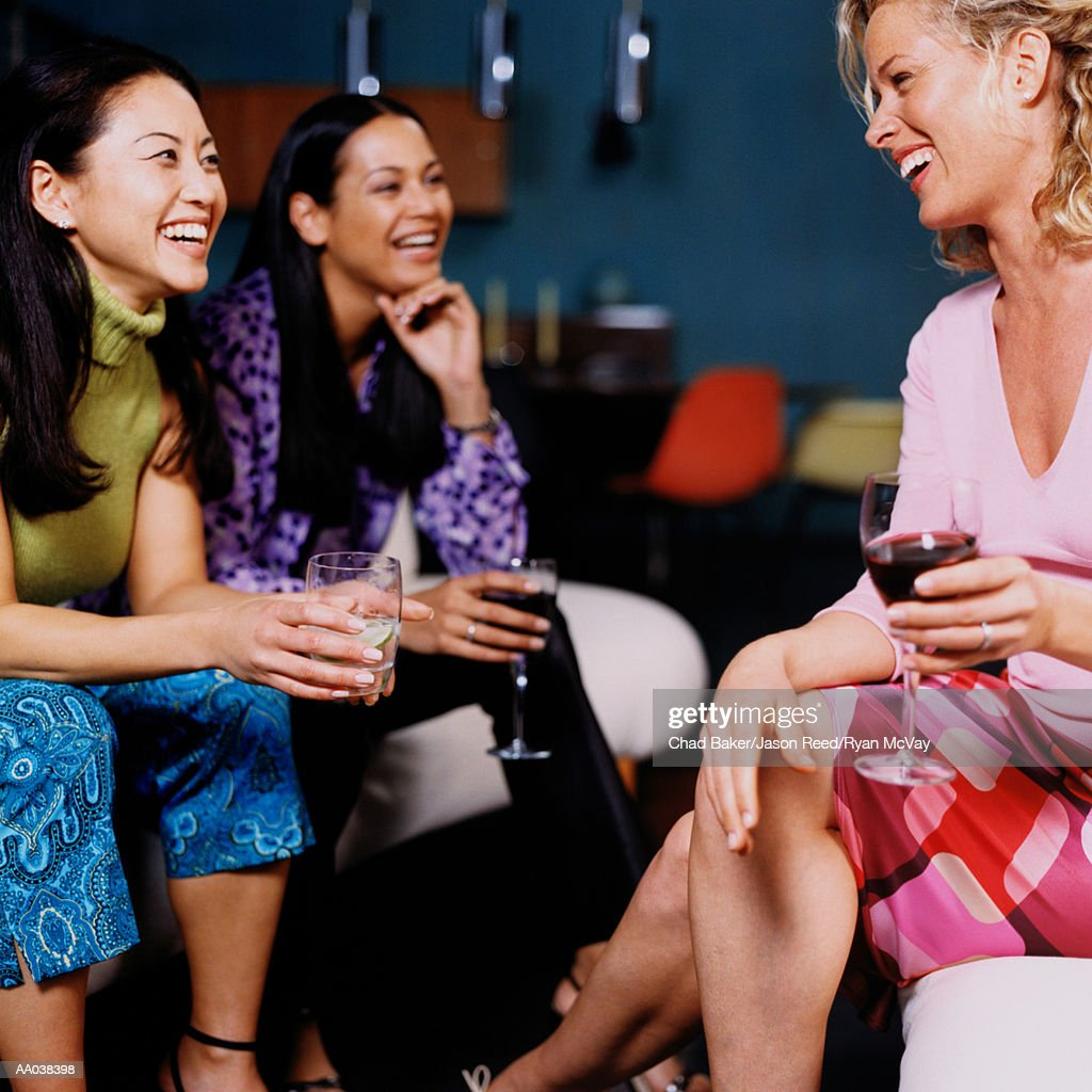 Three Women at a Social Gathering
