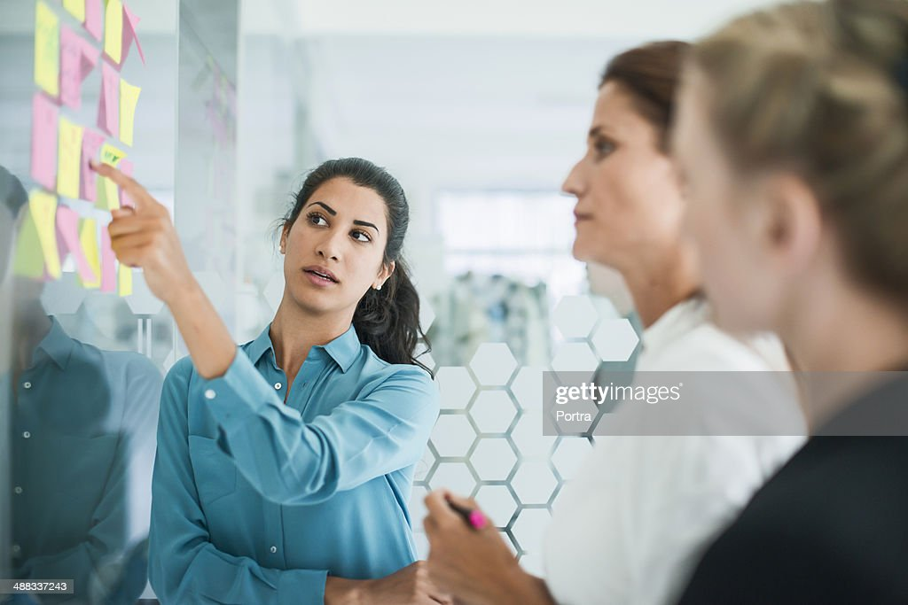 Three women brainstorming