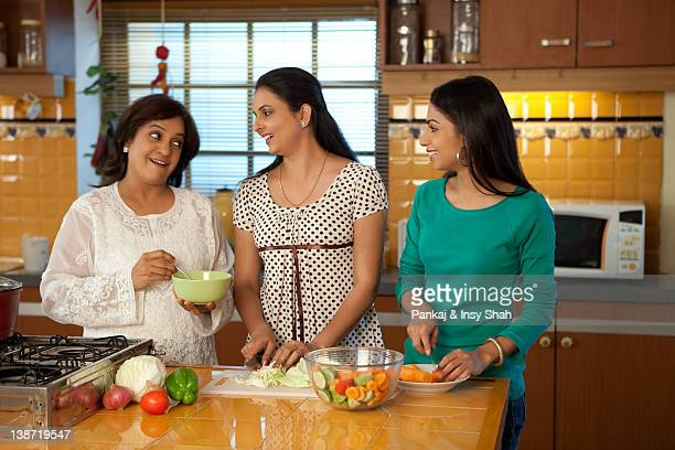Three women cooking in the kitchen