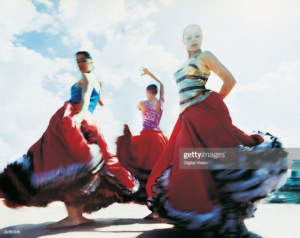 Three Women Dancing the Flamenco