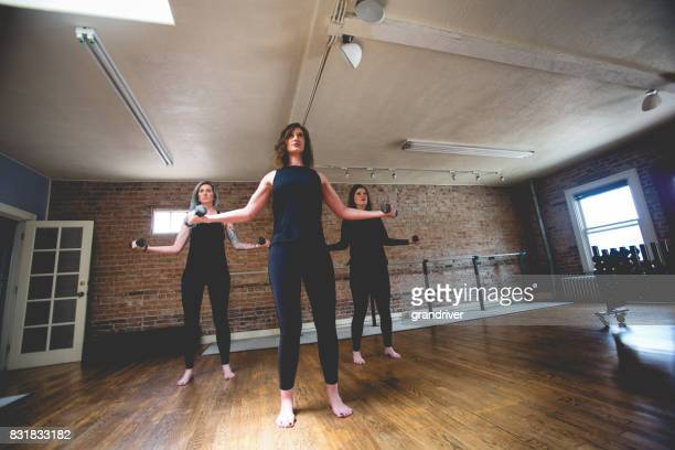 Three Women Doing DumbBell Barre Workout