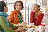 Three women eating and talking