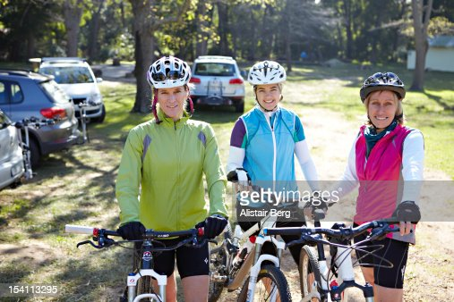 Three women going for a bike ride : Stock Photo