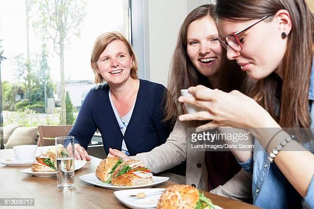 Three women having breakfast in a cafe