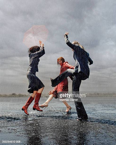 Three women having fun in rain
