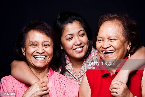 Three women hugging and smiling