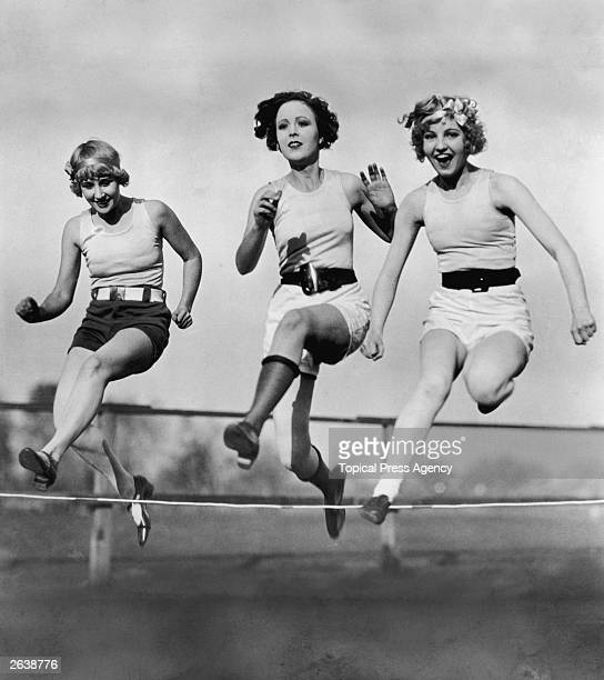 Three women in a low hurdles race at Universal City California USA
