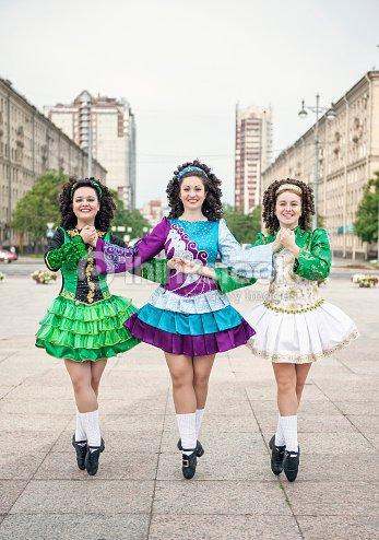 Three Women In Irish Dance Dresses And Wig Posing Stock Photo ... 1b423ca02d