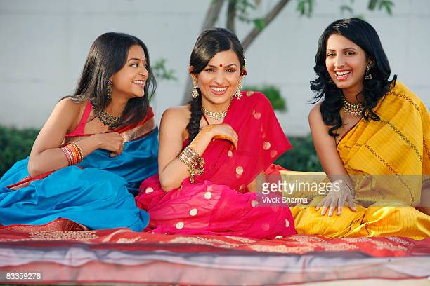 three women in saris