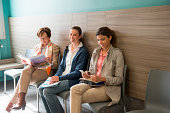 Three women in waiting area of hospital