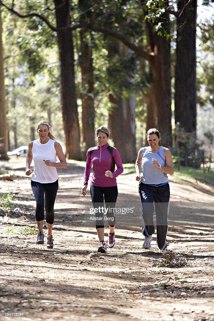 Three women jogging : Stock Photo