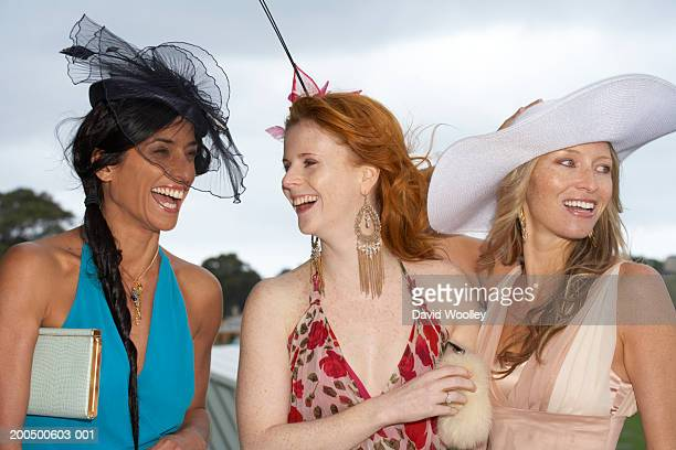 Three women laughing at the races