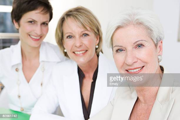 Three women looking into camera