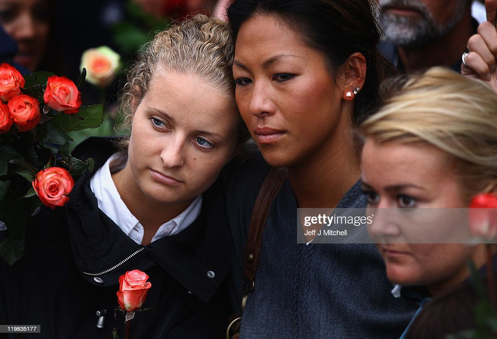 Three women mourners, part of an estimated 100,000 people gathered in Oslo town centre for a vigil following Friday's twin extremist attacks, look on, on July 25, 2011 in Oslo, Norway. Anders Behring Breivik, 32, claimed that he has 'two more cells' working with him as he appeared in court today following a bomb blast at a government building in Oslo and a shooting massacre on nearby Utoya Island that killed at least 76 people in all. The death toll was originally reported as 93. Breivik has been detained for eight weeks, four of which in full isolation.