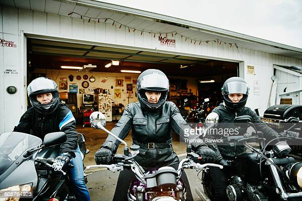 Three women on motorcycles heading out for ride