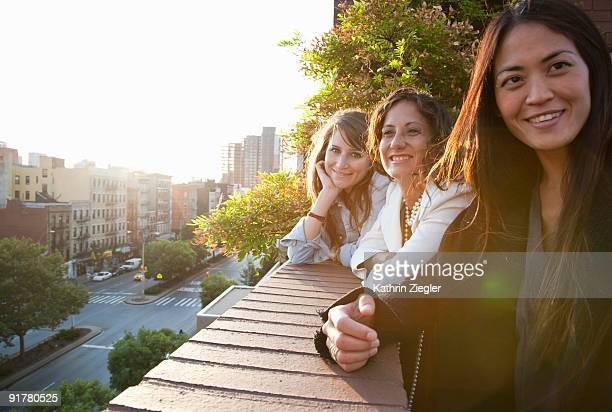 three women on the terrace, sweet afternoon light
