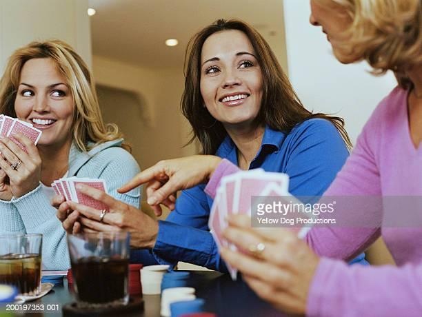Three women playing cards
