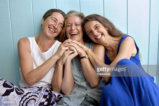 Three women posing and laughing