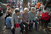 Three women relaxing drinking tea after taking part in morning exercises in Beihai Park an imperial garden to the northwest of the Forbidden City in...