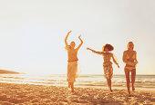 Three Women Running on the Beach