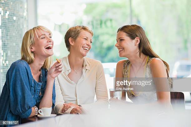 Three women sitting in a restaurant