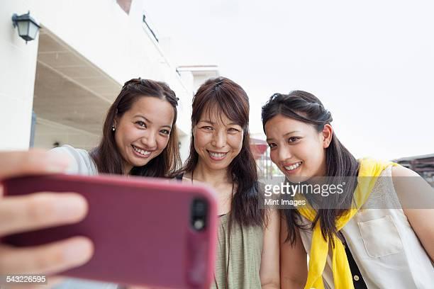 Three women taking a selfie.