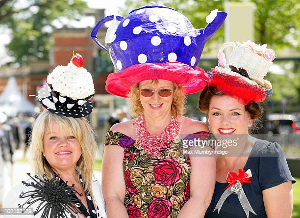 Three women wearing hats fashioned as a Fairy Cake a Teapot and a Cup of Tea attend Royal Ascot Ladies Day at Ascot Racecourse on June 17 2010 in...