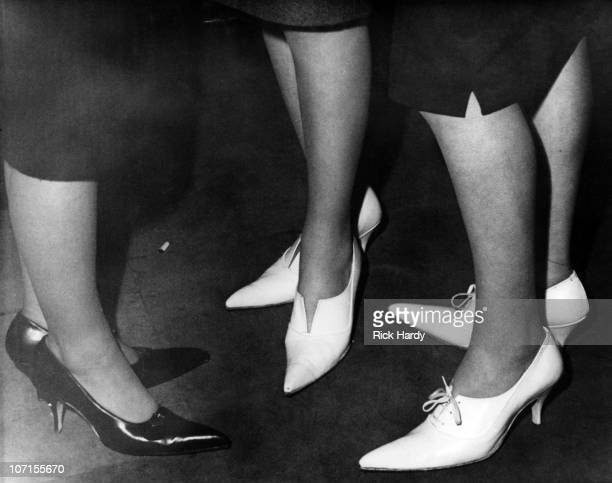 Three women wearing highheeled shoes with winklepicker toes at a coffee bar in London circa 1959