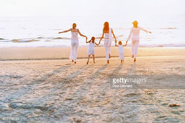 Three Women with Two Girls on Beach